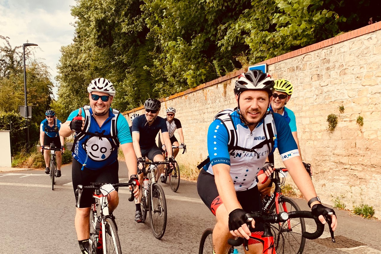 A group of GOSH cyclists on the road