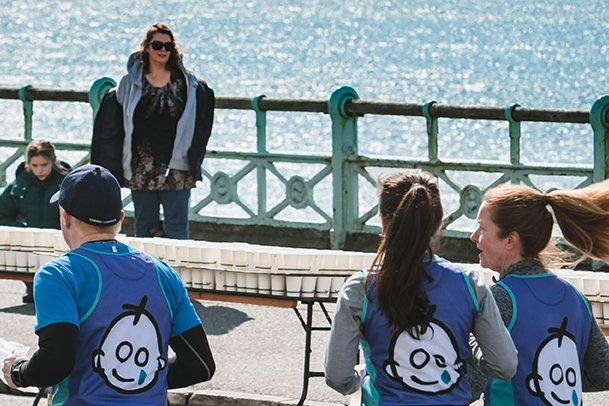 Brighton marathon runners running past the sea
