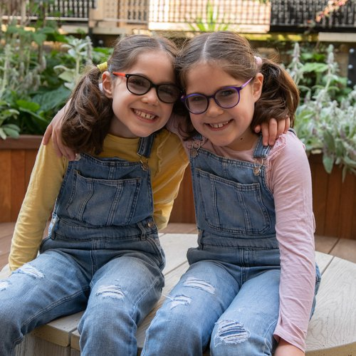 GOSH patients Iona and Beth in the sensory garden in the Sight and Sound Centre supported by Premier Inn