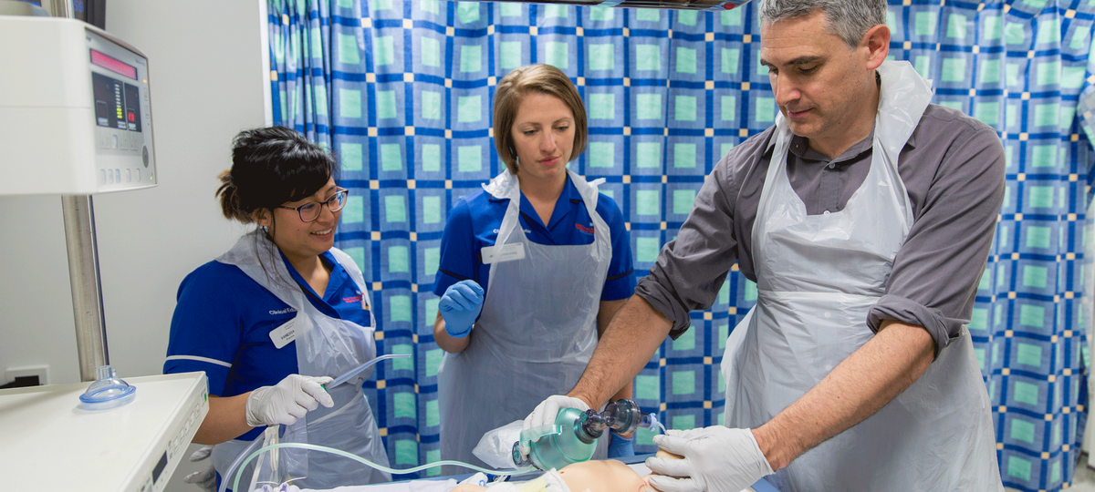 Clinical simulation staff treat mannequin