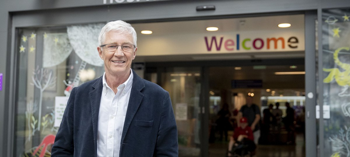 Paul O'Grady outside the front entrance to Great Ormond Street Hospital.