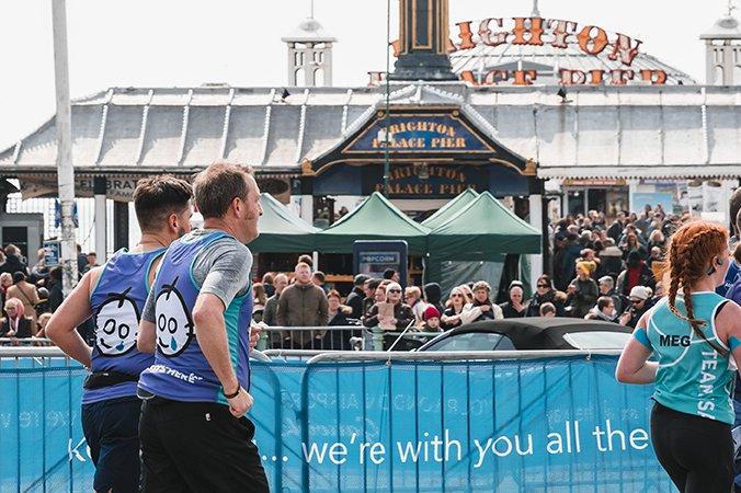 Runners on pier, Brighton Marathon.