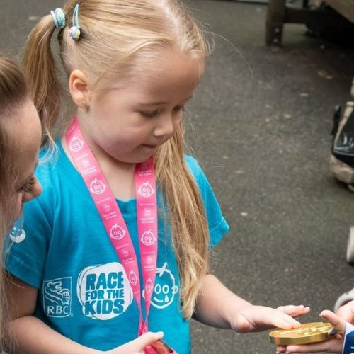 Amelia-Rose holds Beth's gold medal