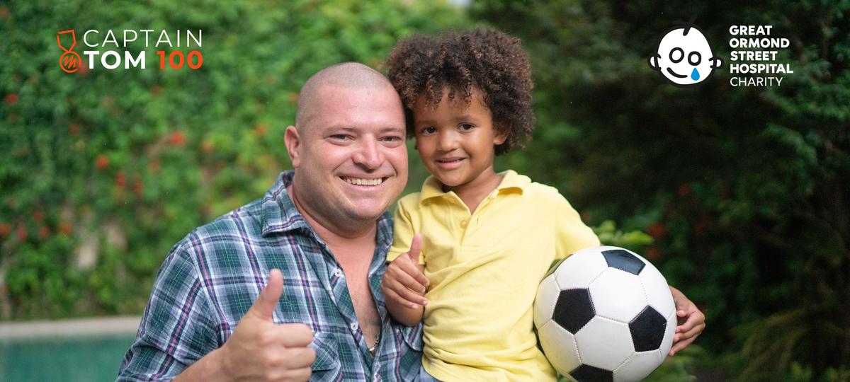 Man and son smiling at camera giving thumbs up