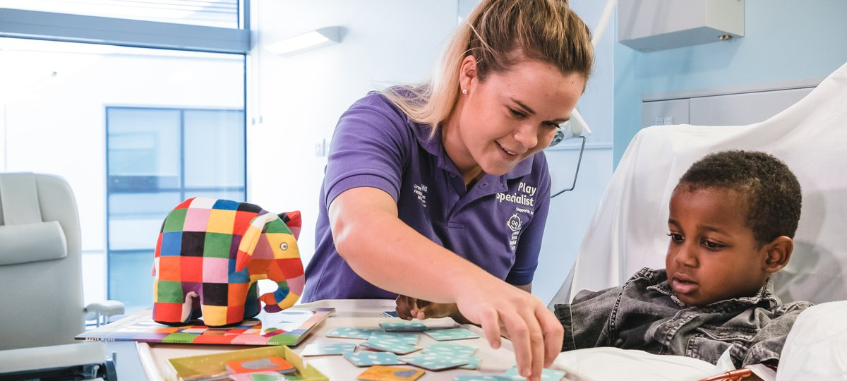 Play specialist helping patient at Great Ormond Street Hospital.