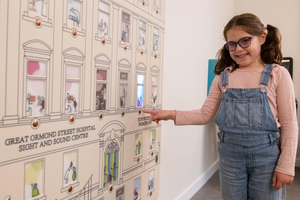 GOSH patient Beth explores the centre's Wayfinding dolls house