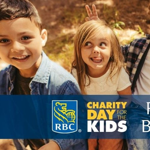 """Four children sit outside smiling with banner reading """"RBC Charity day of the Kids proud 2021 beneficiary"""""""