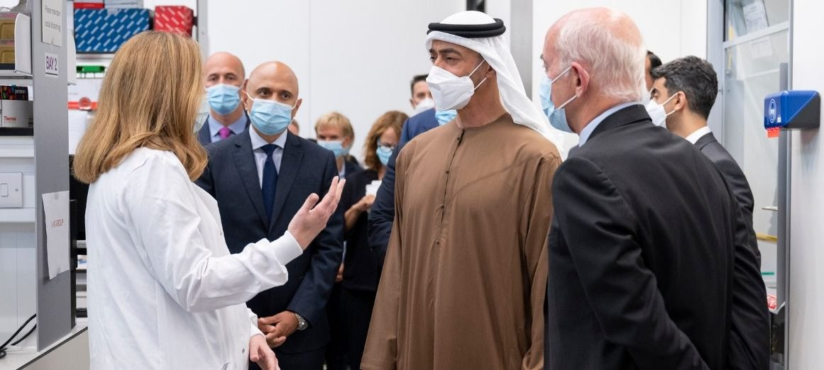 Dr Claire Booth presents to His Highness Mohamed Bin Zayed in lab