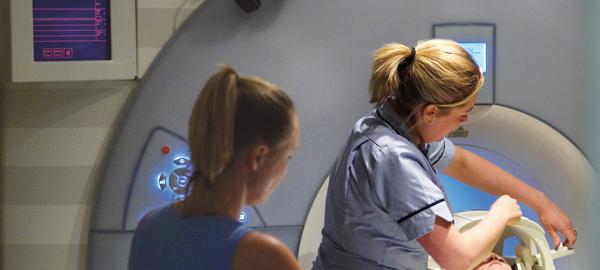 Nurse operating scanner